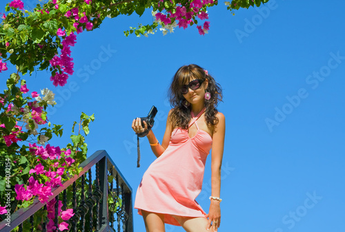 Woman  with camera recorder on holidays