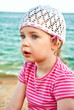 Portrait of cute little girl on the beach