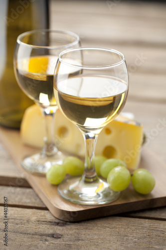 portrait of wine with grapes and cheese