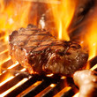 Quadro beef steak on the grill with flames.