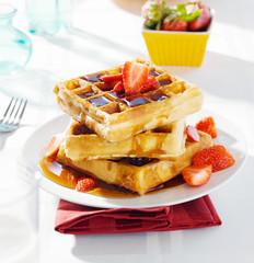 breakfast - waffles with syrup and strawberries