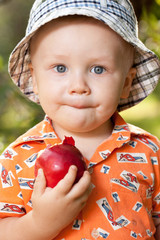 Little boy with a red apple