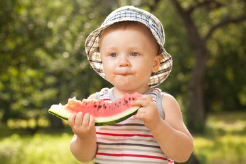 Charming babe with a big slice of watermelon