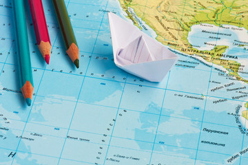 paper ships on the geography map