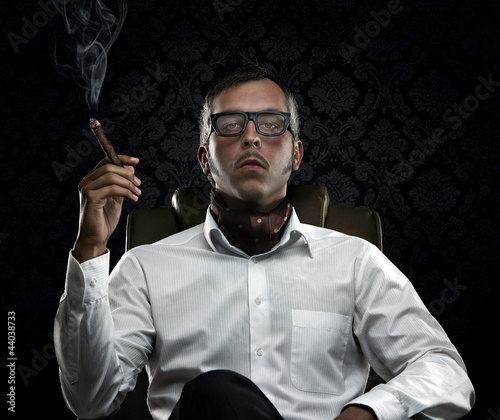 Funny portrait of rich man with serious face expression