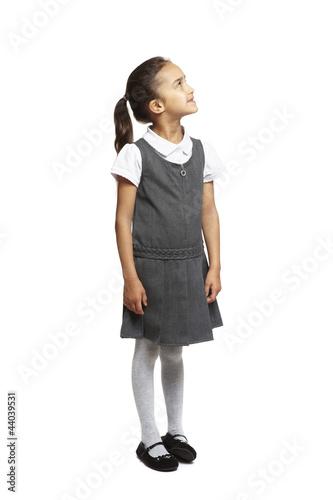 School girl looking up smiling