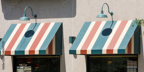 Green Lamps Over Striped Awnings