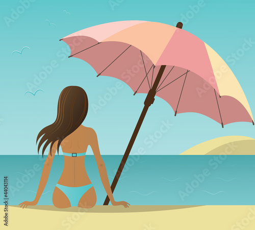 Woman on the beach under umbrella.