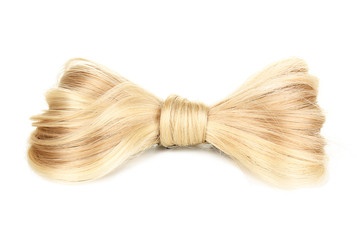 Shiny blond hair-pin isolated on white