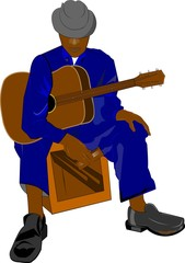 blues guitarist sitting on box