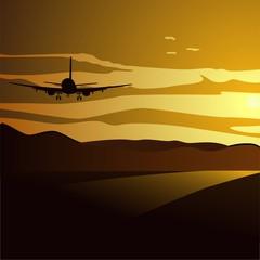 Avión volando hacia la puesta de sol
