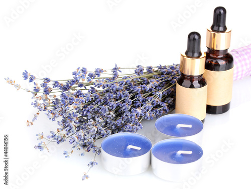 Lavender flowers with aroma oils and candles isolated on white