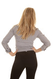 hands on hips woman business