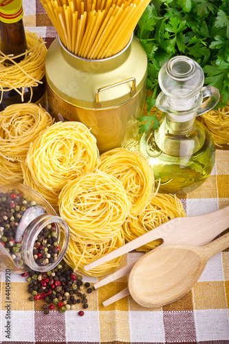 Italian pasta  with olive, spices, cheese and parsley