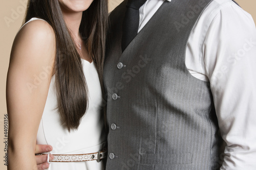 Midsection of casually dressed young couple