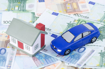 toy house and the car for euro banknotes