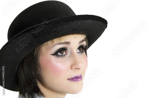 Close-up of young woman wearing hat over white background