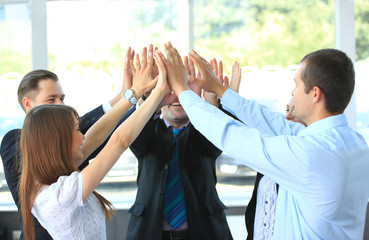 Business team celebrating their success with a high five