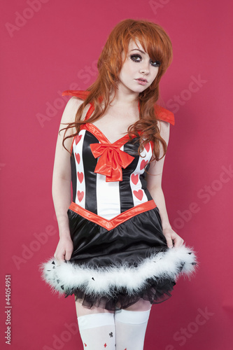 Portrait of teenage girl in dress over colored background