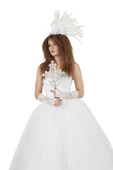 Beautiful woman in wedding dress holding crucifix over white background