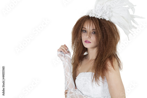 Portrait of beautiful young brunette in wedding gown over white background