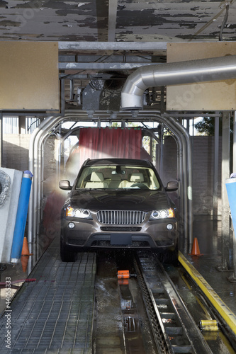 Motor vehicle passing through car wash