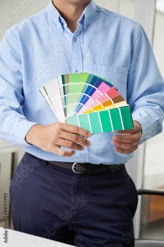 Interior Designer Holding Color Swatches