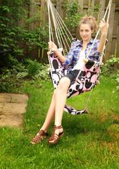 Teen sit in a hammock