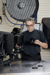 Front view of a technician in photographer's studio