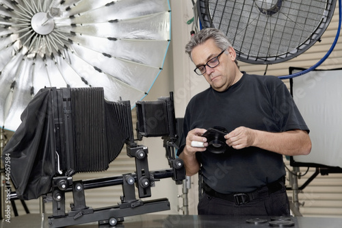 Mature man standing in photographer's studio