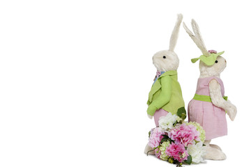 Rabbit couple standing back to back with flower bouquet over white background