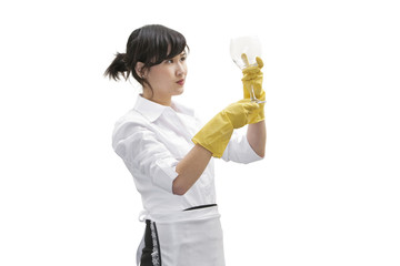Asian house cleaner looking at glass over white background