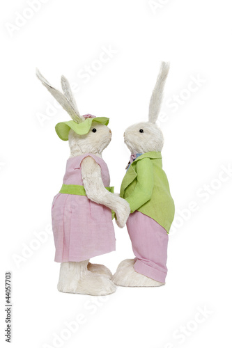 Side view of couple holding hands over white background