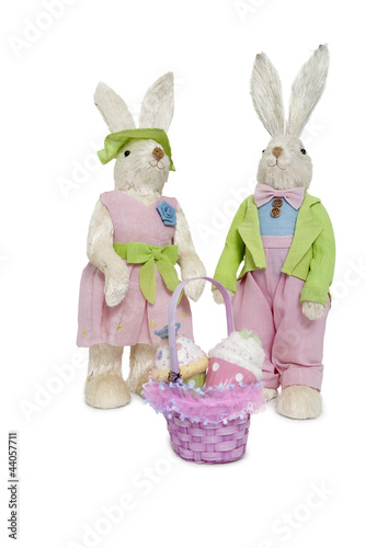 Portrait of stuffed Rabbit couple standing together with basket over white background