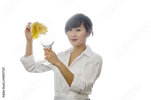 Portrait of Asian woman dusting glass with backlit over white background
