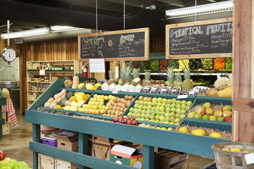 Fresh fruits stall with text on blackboard in supermarket