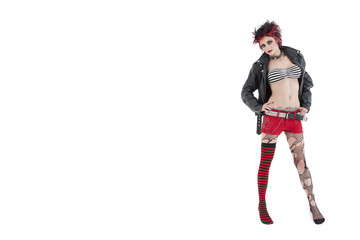 Portrait of beautiful young punk woman posing over white background