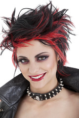 Portrait of beautiful young punk woman with spiked hair