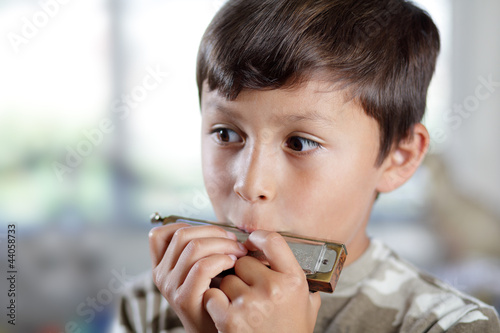 Boy playing harmonica