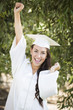 Happy Graduating Mixed Race Girl In Cap and Gown