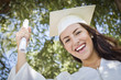 Graduating Mixed Race Girl In Cap and Gown with Diploma
