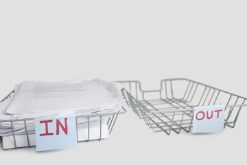 In and out desk trays in an office over white background