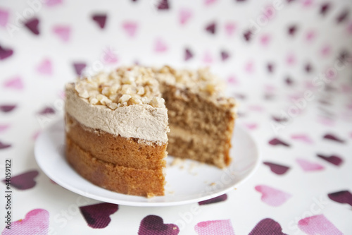 Close-up of cake with missing piece over heart shaped background
