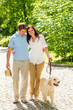 Young couple in love walking dog park