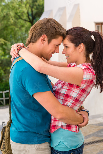 Young happy affectionate couple flirting outdoors