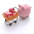 Sparschwein mit Prozenten im Einkaufswagen