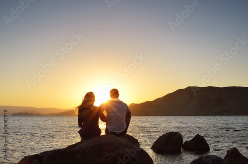 Loving couple looking at the sun