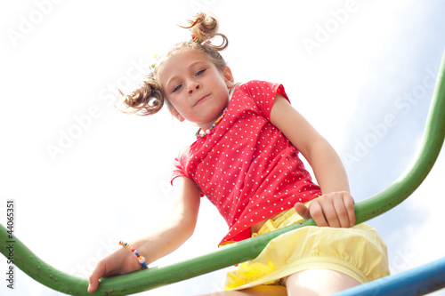 Playful girl playing on the playground