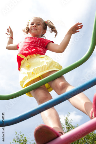 Girl with pigtails plays on the playground