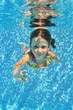 Happy smiling underwater child in swimming pool, summer vacation - 44065783
